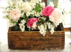 Beautiful arrangement in old ammo box : via Far Above Rubies
