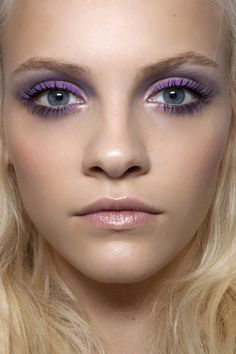 purple eyeliner and grey eyeshadow in crease. Peachy cheeks and light nude gloss.