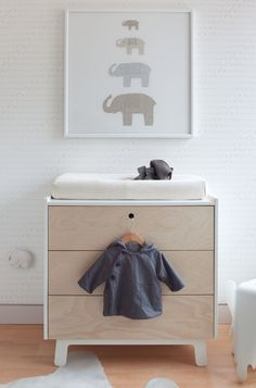 that changing table is some B.S., where are the supplies? love the elephant print though and light neutrals