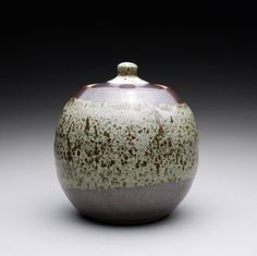 lidded jar - decorative jar with maroon and creamy white wood ash glazes. $100.00, via Etsy - I love Ray Morales Pottery!  Have a few pieces of my own that I'll keep forever!
