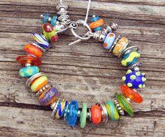 Colorful Summer Lampwork Bracelet. $55.00, via Etsy.