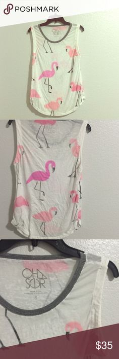 Consigning Soon! Chaser Flamingo Tank Perfect Condition, Chaser tank top in a size small. Love the flamingos! Very soft, great tank for summers or vacations. Please NO Holds, Trades, PayPal or Mercari. Price is firm. Chaser Tops Tank Tops