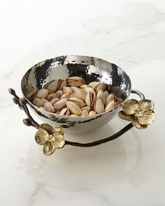This stunning stainless steel and brass-plated and oxidized metal orchid bowl is a glam way to display nuts and other types of food. Or it could be used to hold jewelry and prized possessions.