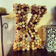 Wine cork idea. This is fun and easy to make at home decor! I made this with wine corks and hot glue. I bought a wooden K from Michaels and apply. I am also finishing a J for my boyfriend made from beer bottle caps. I cant wait to see them together! :)
