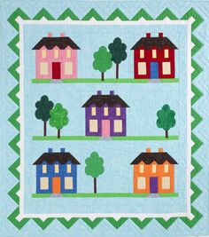 Parkview Lane Wall Quilt Kit: Build a neighborhood full of colorful houses and trees with quick, simple techniques. Pattern designed by the Quiltmaker staff.
