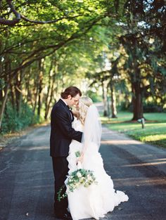 Bride and Groom Under the Trees | Buss Flower Shop | Lehmann Mansion | Britta Marie Photography https://www.theknot.com/marketplace/britta-marie-photography-chicago-il-520934
