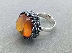 Vintage 1970's Einer Fehrn Danish sterling silver amber modernist ring Found on Etsy from FrancisBrownJewelery, Canada.