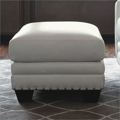 Lexington Black Ice Sapphire Leather Ottoman in White - This ottoman has a gorgeous white leather finish. It features ultra down seat cushions and nailhead trim. Combine it with the Black Ice Sapphire Leather Sofa and Chair for a complete set. With contemporary design elements, the Black Ice Sapphire Leather Ottoman is sure to make your living room inviting and comfortable.