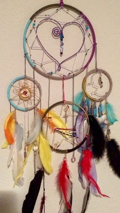Finally!  This is the dreamcatcher I finally made for myself. The sun and moon represent my girls, my star represents my love. I loved making every part of this catcher. I will post each catcher individually as well.