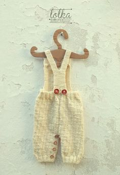 Handknit white baby overall with 100% merino wool. Knitted baby overall. Winter baby clothing.