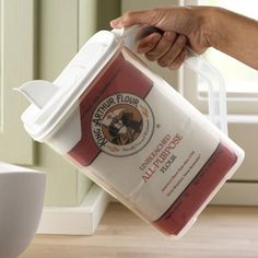 Where has this been all my dang life!! Okay, this is cool. :) Store and pour your flour and sugar. No more messes trying to scoop directly out of the bag or container!