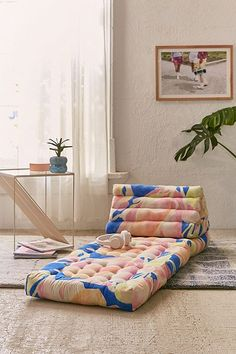Shop Convertible Printed Triangle Floor Cushion at Urban Outfitters today. We carry all the latest styles, colors and brands for you to choose from right here. Sofa Futon, Deco Cool, Triangle Pillow, Single Chair, Floor Seating, Floor Pillows, Kids Floor Cushions, Throw Pillows, Chair Cushions