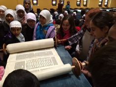 Showing the Islamic students the Torah.