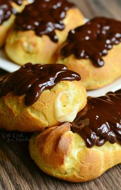 Homemade Boston Cream Eclairs. Made with simple pate au choux, filled with homemade vanilla bean custard and topped with rich chocolate ganache.