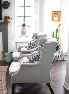 light gray chairs with patterned pillows