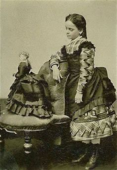 Little Victorian girl #twinning with her doll in matching bustle dresses, ca. 1880s. #victorian #antique #photography #history