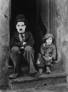 """The iconic photo of Charlie Chaplin and little Jackie Coogan (Uncle Fester in the Addams Family) from """"The Kid"""" (1921)."""