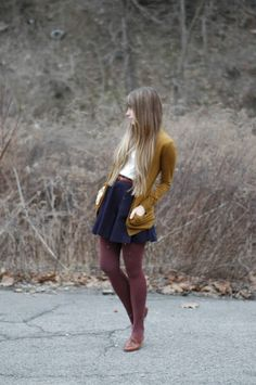 White Top with Navy Blue Pleated Skirt and Goldenrod Yellow Long Cardigan with Burgundy Tights and Accessories