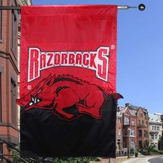 """Arkansas Razorbacks Applique & Embroidered 28"""" x 40"""" Premium Banner Flag by Custom Decor. $22.29. UV Protected. Weather Resistant. Whether it is tailgating or a backyard barbeque, cheer on your team with a NEW Game Day Flag! You will love the vibrant colors of this American made large flag. Display it with pride in your front yard, garden or favorite tailgating spot. This large flag measures 28 inches by 40 inches. You will appreciate the soft feel, fine knit and..."""