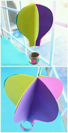 I bet I could use a cardboard drawer separater, glue, and felt hot air balloon shapes and make these for the playroom!!