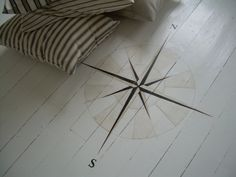 compass painted on to floor (idea of a painted wind rose)