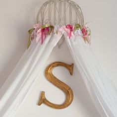 This bed canopy was built from a planter, ribbon and IKEA drapes. I just hung the planter upside down on the wall. I then sewed ribbon to the top of the IKEA drapes to attach the drapes to the planter. Also ceiling medallion painted pink. Little Girl Rooms, Little Girls, White Girls, Pink White, Mint Room, Polka Dot Chair, Kura Bed, Ideas Hogar, Head Boards