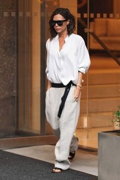 En route to her spring/summer 2017 show, Victoria Beckham debuted a surprisingly androgynous look, teaming a soft shirt with slouchy trousers - similar to those that dominated her latest collection for her diffusion line - and sandals. She did not, however, forgo her signature dark glasses.