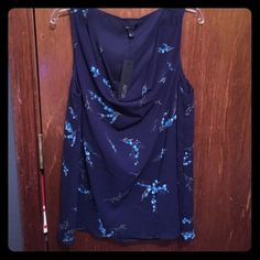 NWT sleeveless APT9 shirt This is a never worn, new with tags, blue, floral sleeveless shirt. 100% polyester. Smoke free, pet free home. Apt. 9 Tops Blouses