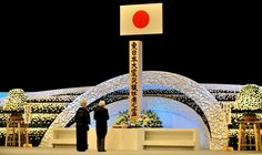Japanese Emperor Akihito (R) and Empress Michiko pay their respects before an altar during a memorial service for the victims of the march 11, 2011 earthquake, in Tokyo on March 11, 2012. Photograph: Yoshikazu Tsuno/AFP/Getty Images