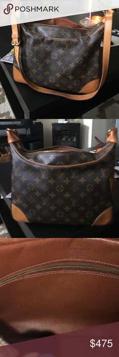 Louis vuitton handbag . Authentic medium size shoulder bag.Louis Vuitton Paris made in france .100 percent guaranteed authentic or money back .Date code has worn off on inside pocket .Excellent condition other than inside the inside  pocket is peeling inside pocketbook.Sorry price is firm i will not be accepting any trades or any lower price. Louis Vuitton Bags Shoulder Bags