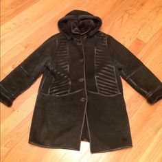 Shearling coat Stay warm this winter! Beautiful shearling coat. Really warm and light. Good condition. Dark gray. Size medium but fits a large (size 10-12) Jackets & Coats