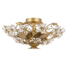 """Bring glittering style to your living room, dining room, or foyer with this elegant semi-flush mount, featuring a wrought iron frame and crystal flower accents.   Product: Semi-flush mountConstruction Material: Wrought iron and Swarovski spectra crystalColor: Gold leafFeatures: UL and CUL listedAccommodates: (6) 60 Watt candelabra bulbs - not includedDimensions: 8.5"""" H x 16"""" Diameter"""