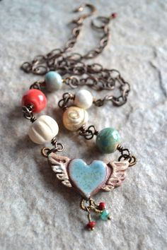 Winged Heart Ceramic Bead Necklace in Blue by TheJunquerie on Etsy, $65.00