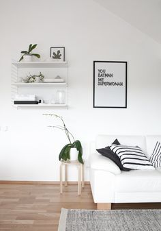 Love the monochrome with wood and green plants in this Scandinavian living room - white walls, white sofa, and string shelf. Small Living Room Layout, Living Room White, Small Living Rooms, My Living Room, Living Room Decor, Minimalist Home Decor, Minimalist Interior, Minimalist Style, Interior Design Living Room