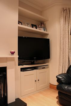 Fitted TV alcove cupboard and floating shelves