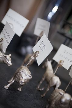 dollar store animals + wire + spray paint = labels for food table   from off beat bride