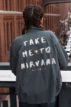"""Follow your soul. It knows the way. Start the path in our fashion army jacket. Oversized fit (order one size down for regular fit) matte buttons, and front zipper pockets. Handwritten """"Take Me to Nirv"""