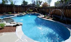 This custom swimming pool designed and built by Lifetime Pools features a waterfall, grotto, slide and sunken bar. Swimming Pool Images, Swimming Pool Designs, Swimming Pools, Simple Pool, Outside Pool, Swimming Pool Construction, Pool Decks, Pool Backyard, Pool Builders