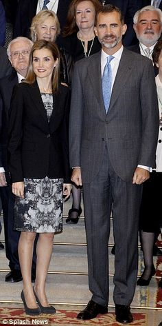 Chic: Letizia was glamorous in a grey printed dress