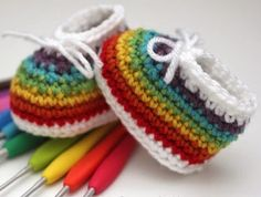 Rainbow Easy Crochet Baby Booties   How adorable are these easy crochet baby booties? Rainbow stripes and cute cinched bow—you can't ask for more!