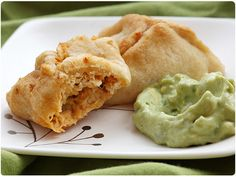 Buffalo chicken poppers with blue-cheese-avocado dip