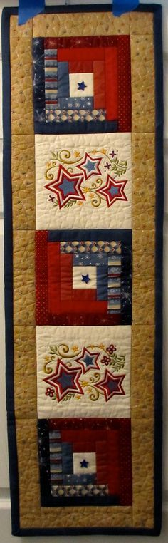Combination of Mix & Match Jelly Roll Quilt Blocks and American designs from Anita Goodesign.  Fabric is from American Celebration line from Connecting Threads.