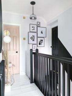 Love the black banister with the nude pink door Black And White Hallway, Black Door, Black Banister, Painted Banister, White Floorboards, Painted Floorboards, Narrow Hallway Decorating, Narrow Bedroom Ideas, Tiled Hallway