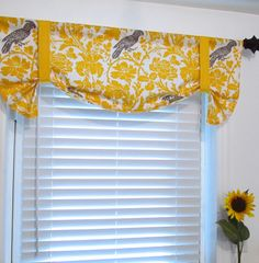 Tie Up Curtain Valance...michelle do you like this style of curtain?  Maybe a little longer but not all the way down so we could still use the sill?