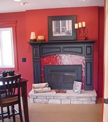 Bold color contrasts mark this fireplace surround designed and installed by DreamMaker in Grand Rapids, MI.
