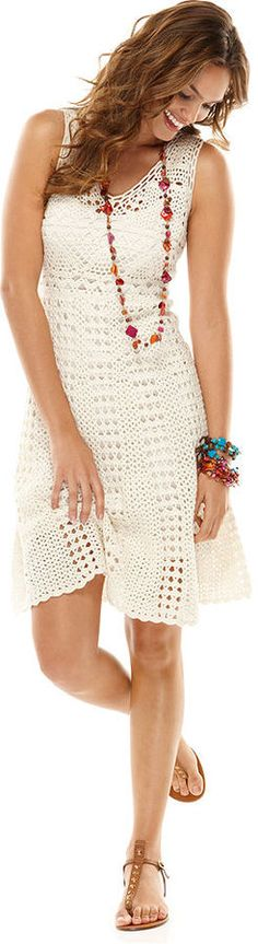 Maggy London's crocheted dress is infused with a chic, carefree attitude and begs to be paired with colorful accessories! Cotton; lining: polyester Hand wash Imported Inspired by Brasil Scoop neckline Pullover style Crochet overlay Scalloped hem Fitted Lined Hits at knee Colors: Ivory Sizes: XS, S, M, L