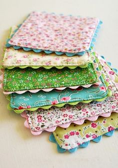 DIY coasters out of floral fabric Could make them a little larger and use for hot pads :)