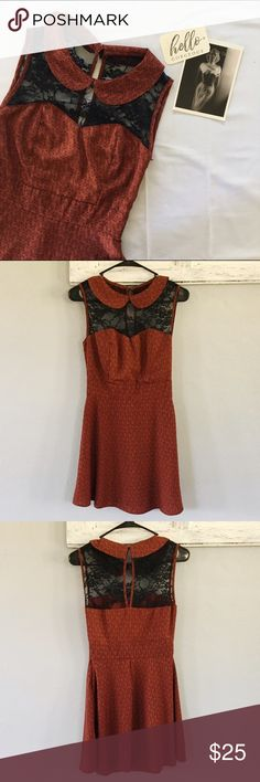 Vintage inspired star pattern dress w/ black lace Beautiful burnt orange star patterned dress with Peter Pan collar, black lace detail on the front and back. Condition is amazing. No size tag, looks like an XS.  Measurements in inches with the garment laying flat •armpit to armpit: 14 •waist: 13 •length: 34 ModCloth Dresses Mini