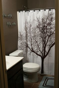 brown bathroom and tree curtain