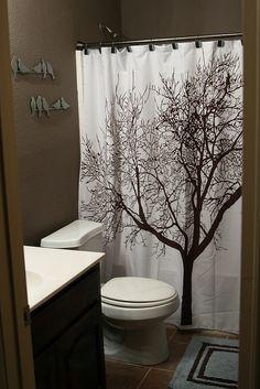 brown bathroom and tree curtain